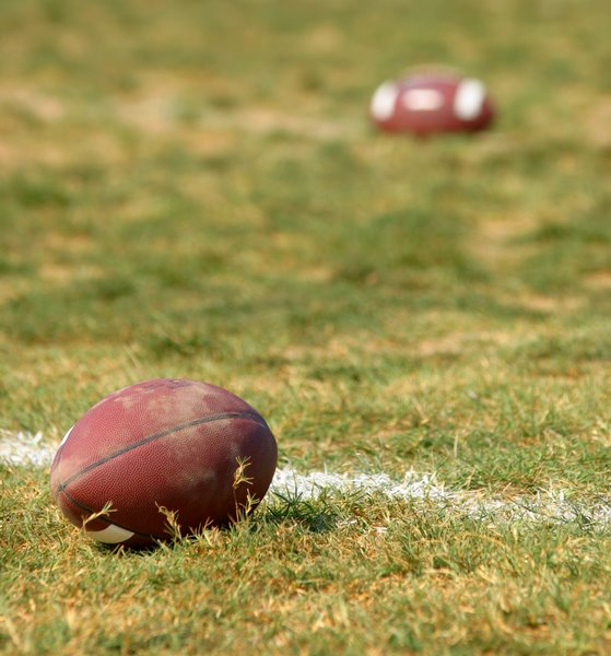 Footballs in field