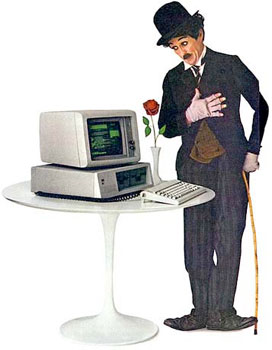 Charlie Chaplin standing next to an IBM PC