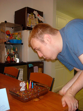 Russell blowing out the candles on his 23rd birthday.