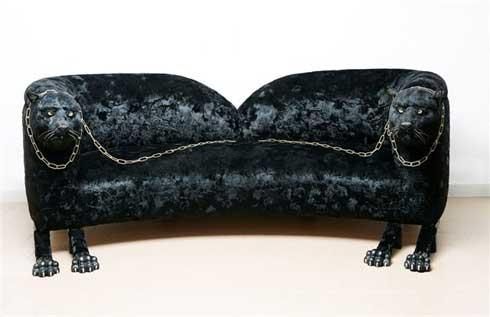 A sofa with Panther heads.