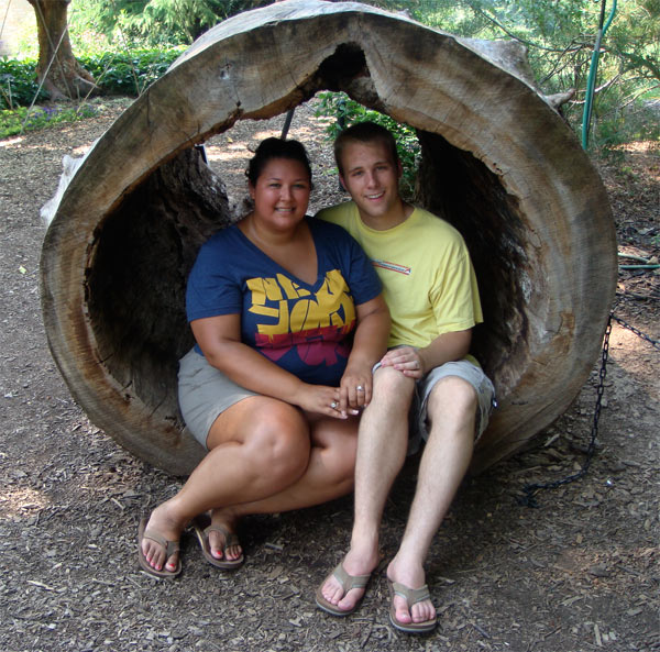 Kristina and Russell sitting in a log