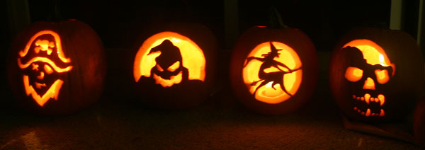 Four Carved Pumpkins