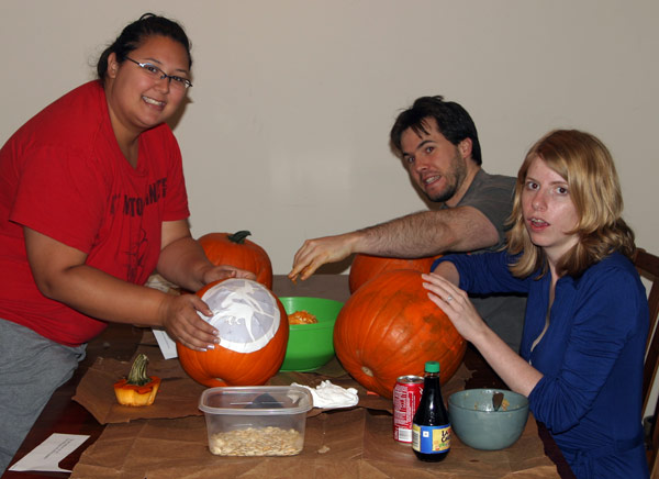 Roommates carving pumpkins for Halloween
